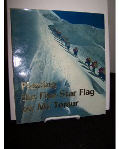 Planting the Five-Star Flag on Mt. Tomur.